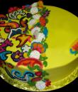 Jacobean Paisley Birthday Cake. Yellow buttercream iced, round decorated with edible applique jacobean flair and paisley designs. Everything on this cake is edible. (Serves 8-80 party slices.)