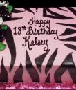 Pink Zebra 18th Birthday Cake. Pink buttercream iced, sheet cake decorated with zebra stripes and black and white roses. Everything on this cake is edible. (Serves 24-98 party slices.)